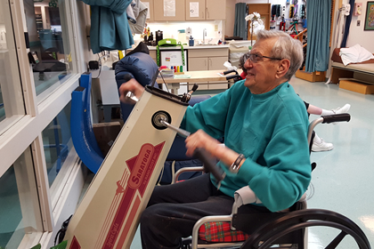 Man using rehabilitation equipment at Brevillier Village.