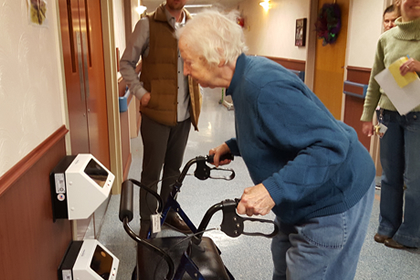 Brevillier resident uses the IRIS retinal identification scanner to open a secure door in Barnabas Court North.