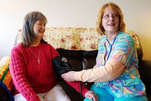 Brevillier Village nurse taking residents blood pressure.