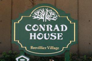 Conrad House Sign at Brevillier Village.